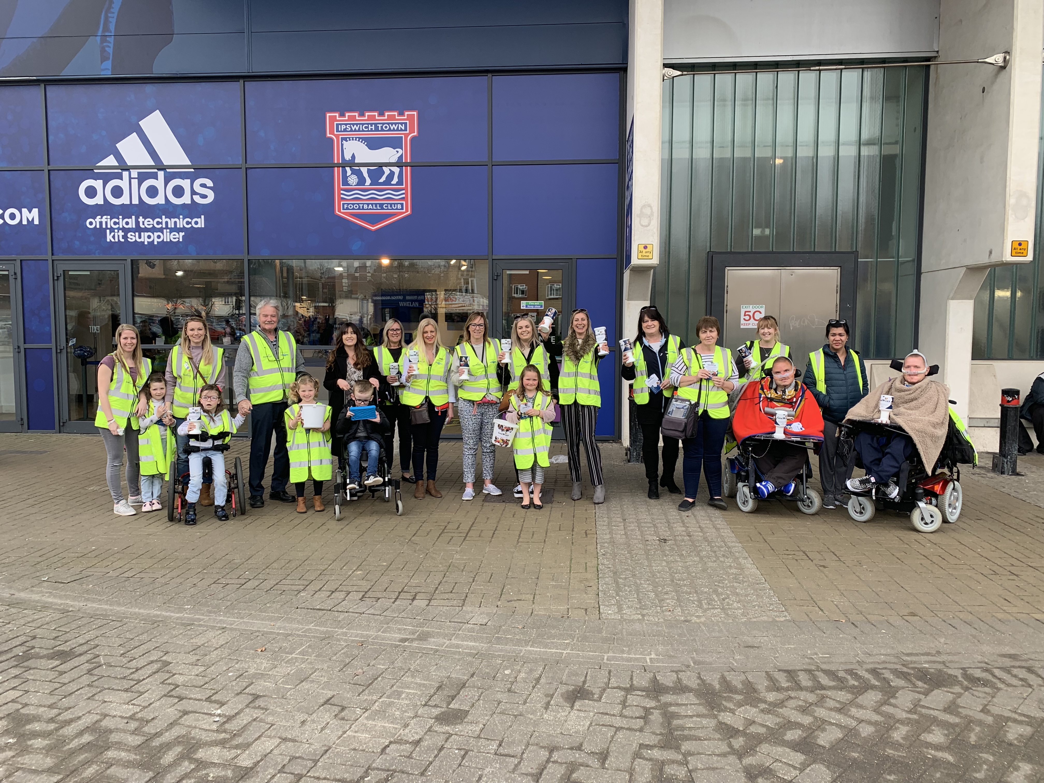 GeeWizz Families collect donations outside Ipswich Town FC