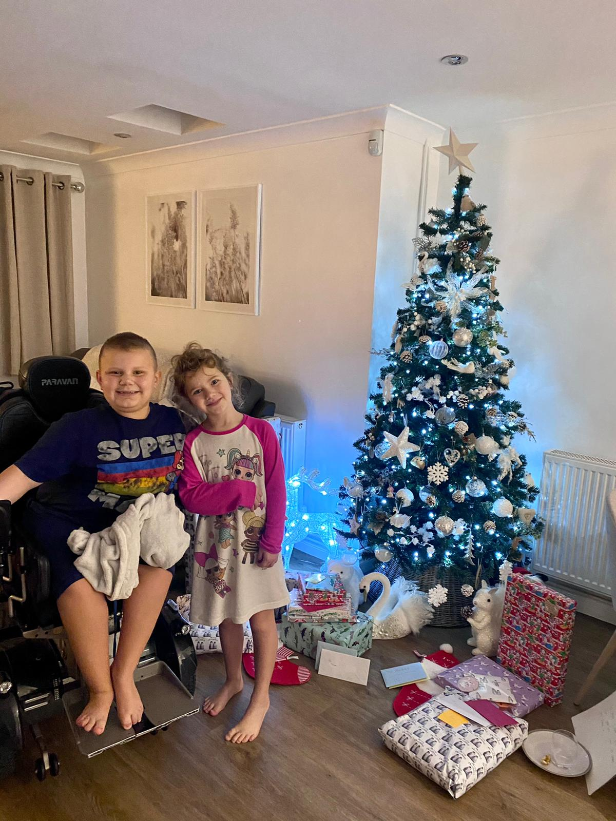 GeeWizz children receive new trainers for Christmas after a special donation from Michelle Anastasiadis